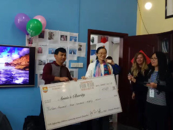 Hand over cheque to Annie's Charity
